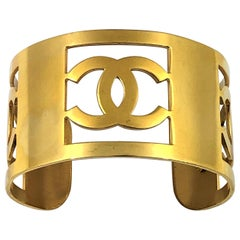 Vintage Chanel 1 3/8 inch Wide Gold Tone CC Cuff 1993 Cruise Collection