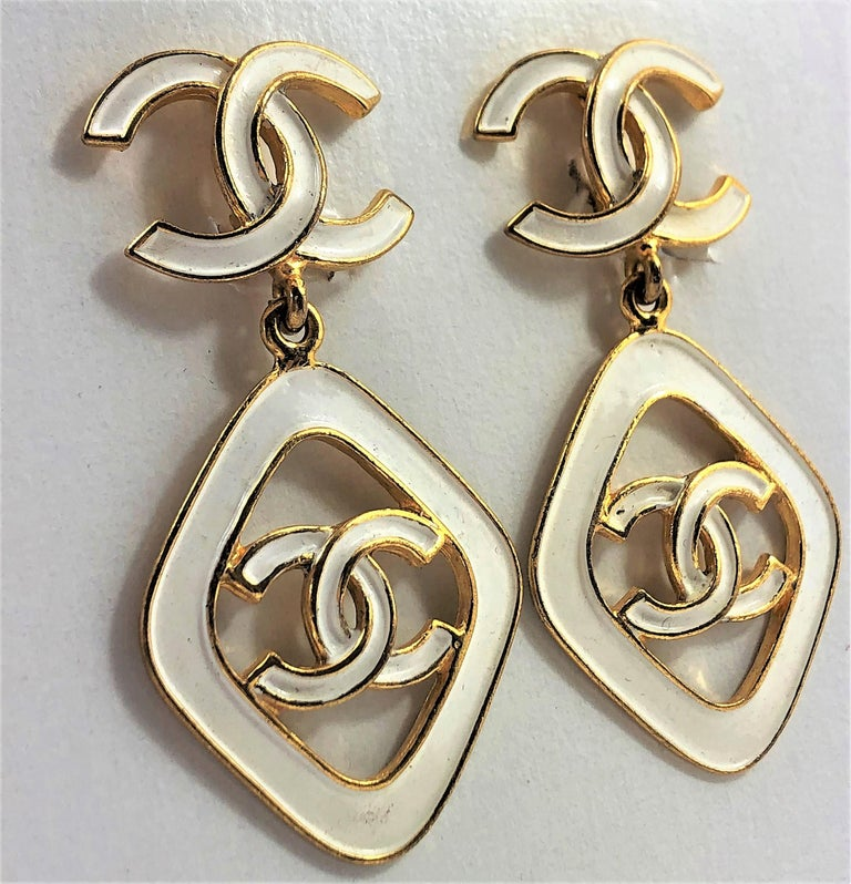 Great for summer! These lovely white enamel earrings have the CC logo both on the top and bottom. Measuring 2.5 inches long by 1.25 inches across. Made in 1993 for the Cruise Collection. Marked Chanel 93 CC C Made In France.