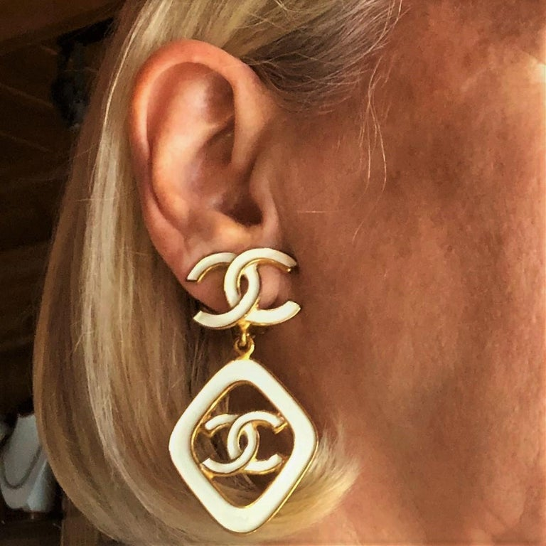 Vintage Chanel 2.5 Inches Long White Enamel on Gold Tone Metal Earrings For Sale 2