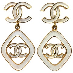 Vintage Chanel 2.5 Inches Long White Enamel on Gold Tone Metal Earrings