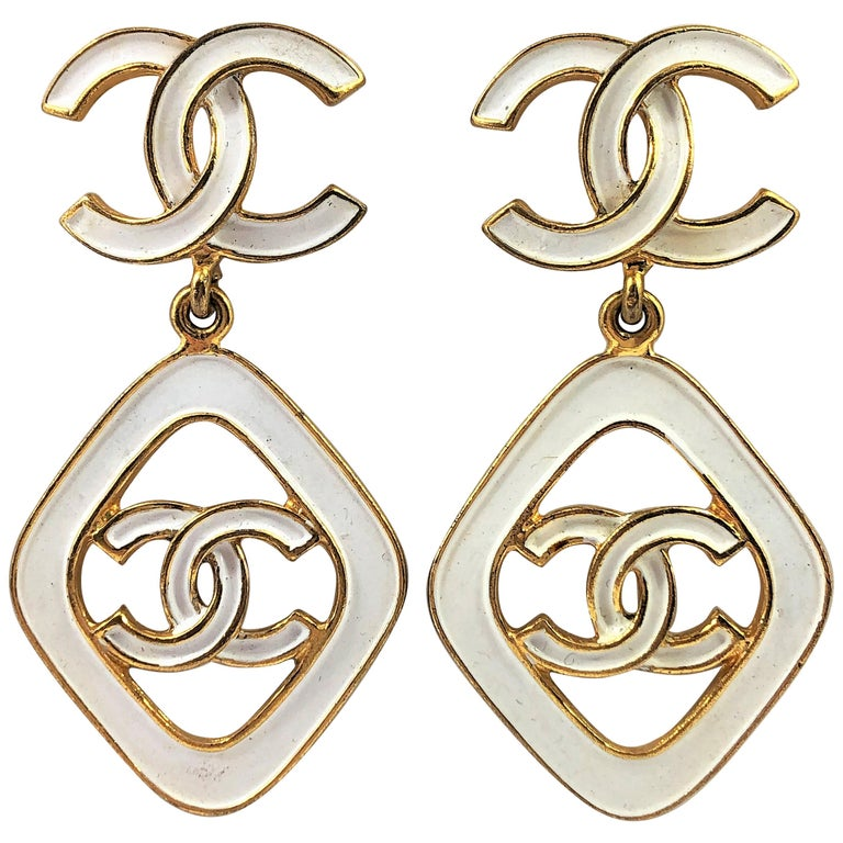 Vintage Chanel 2.5 Inches Long White Enamel on Gold Tone Metal Earrings For Sale