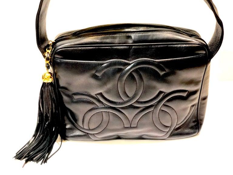 - Vintage Chanel 28cm navy lambskin triple