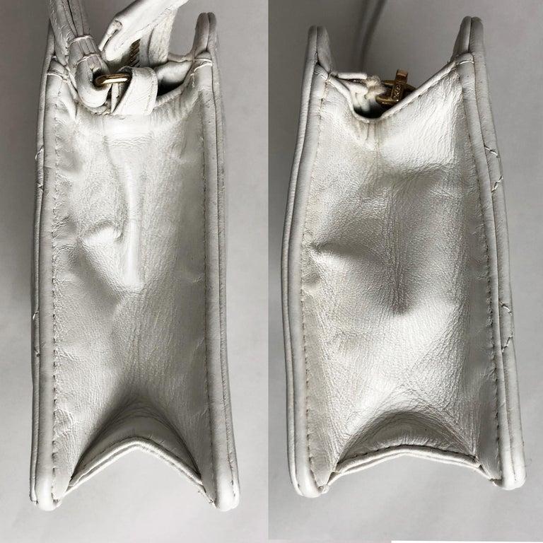 Women's or Men's Vintage Chanel Bag CC Logo Matelasse Clutch Wristlet White Leather Evening Bag