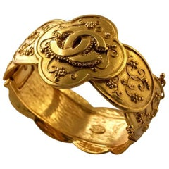 Vintage CHANEL Baroque Logo Hinged Bracelet Cuff