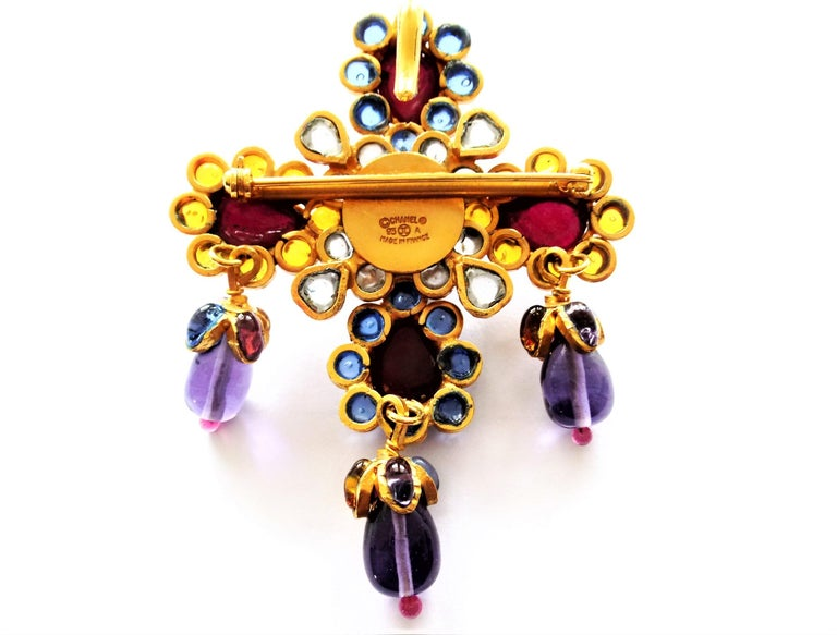 A wonderful Chanel brooch, also to wear as a pendant, from Gripoix. The metal work of Robert Goossens Paris and each blossom and the drops are filled with liquid glass in blue, yellow, purple, red and clear from the Maison of Gripoix. The brooch is