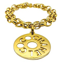 Vintage Chanel Coco Chanel Cut Out Gold Logo Medallion Necklace 1980s