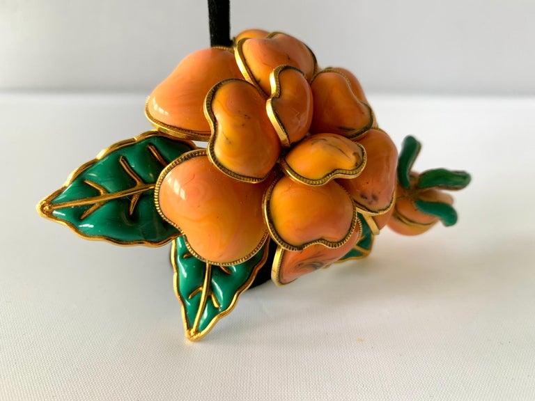 Unusual and scarce Coco Chanel double camellia brooch, exquisitely handcrafted out of coral and emerald green