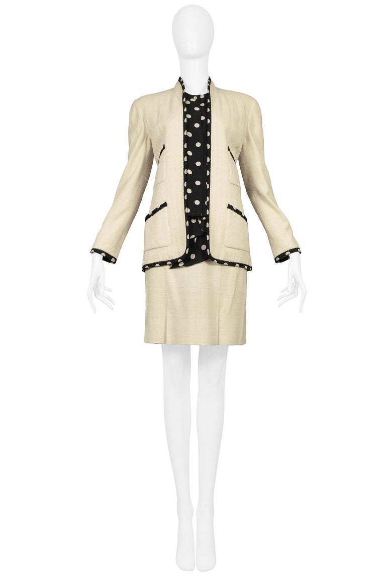 Vintage Chanel cream linen skirt suit. Open front suit jacket with front pockets trimmed in polka dot silk. Set includes matching box pleat skirt with silk polka dot fabric waist and coordinating silk blouse. This ensemble is a 3-piece