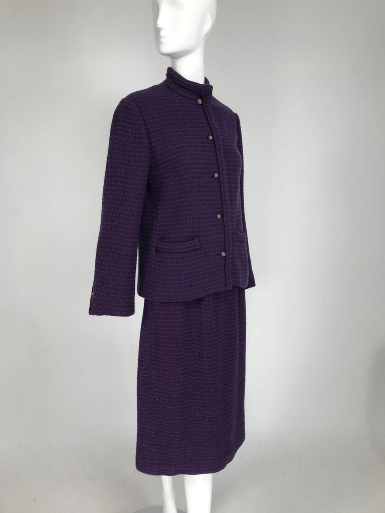 Vintage Chanel Creations purple wool skirt suit with purple & gold lion head buttons at the front & cuffs, gold chain hem in the lining. Mid weight waffle textured wool jacket, with band collar, princess seams, single button front, long sleeves have