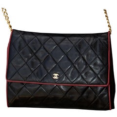 Vintage Chanel Crossbody Black Leather with Red Piping bag