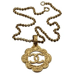 Vintage CHANEL Cutout Logo Flower Necklace