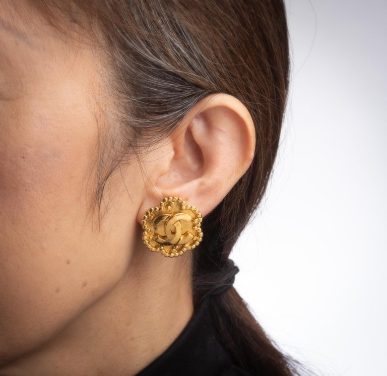 Modern Vintage Chanel Earrings  Circa 1996 CC Logo Flower Clip On Yellow Gold Tone For Sale