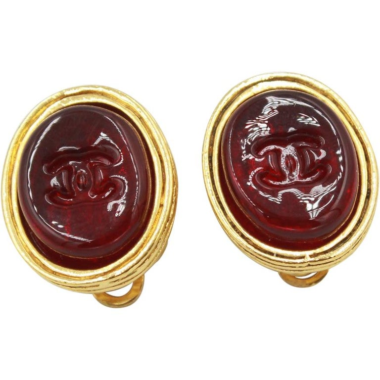 Vintage Chanel earrings in Gold metal and red poured glass For Sale