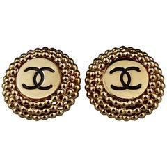 Vintage CHANEL Enamel Logo Raised Disc Medallion Earrings