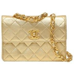 Vintage Chanel gold leather shoulder bag