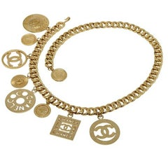 Chanel Vintage chain belt with multiple dangling logo charms