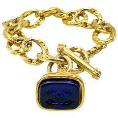Vintage Chanel Gripoix Charm Bracelet with Blue Pate de Verre Seal Fob 1990s