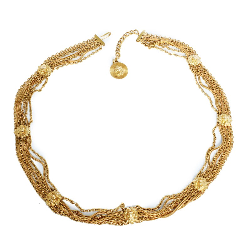 Authentic, preowned, vintage Chanel lion head medallion multi chain belt, circa the late 70s. Made from gold metal, it features Coco Chanel's iconic lion head as medallions with chains throughout. Preowned/vintage w/some signs of use & prior wear: