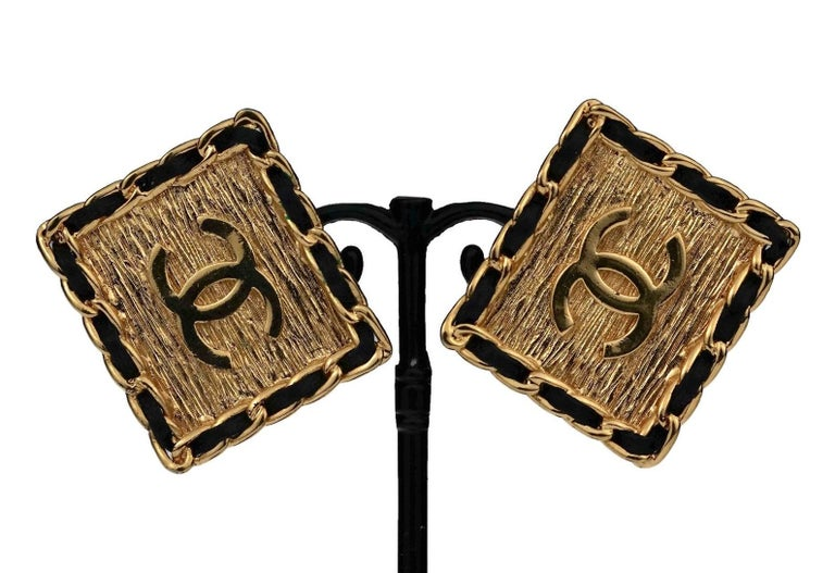Vintage CHANEL Logo Chain Leather Square Earrings  Measurements: Height: 1.30 inches (3.3 cm) Width: 1.53 inches (3.9 cm) Weight per Earring: 13 cm  Features: - 100% Authentic CHANEL. - Chanel classic leather chain earrings. - Rectangular form with