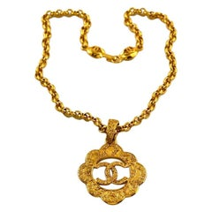 Vintage CHANEL Logo Cutout Flower Necklace