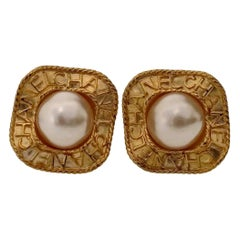 Vintage CHANEL Logo Pearl Concave Earrings