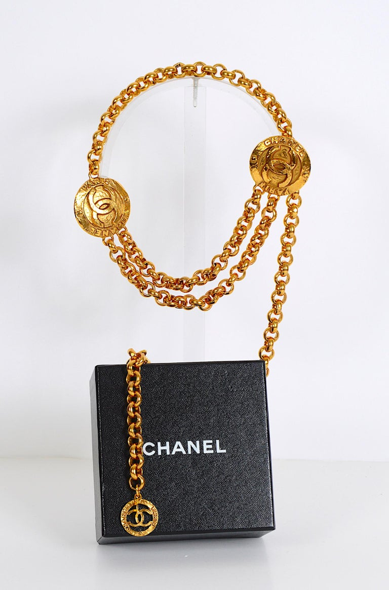 Authentic Chanel chain belt in Goldtone. It can fit smaller sizes since the hook can be attached to any place on the chain. Chanel 2 CC 8 Made in France 6120 engraved on the medallion hook. Total length chain 33inches/84cm.  In fabulous vintage