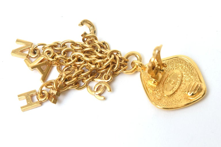 Women's Chanel Gold Plated Charm Dangle Clip On Earrings Vintage For Sale