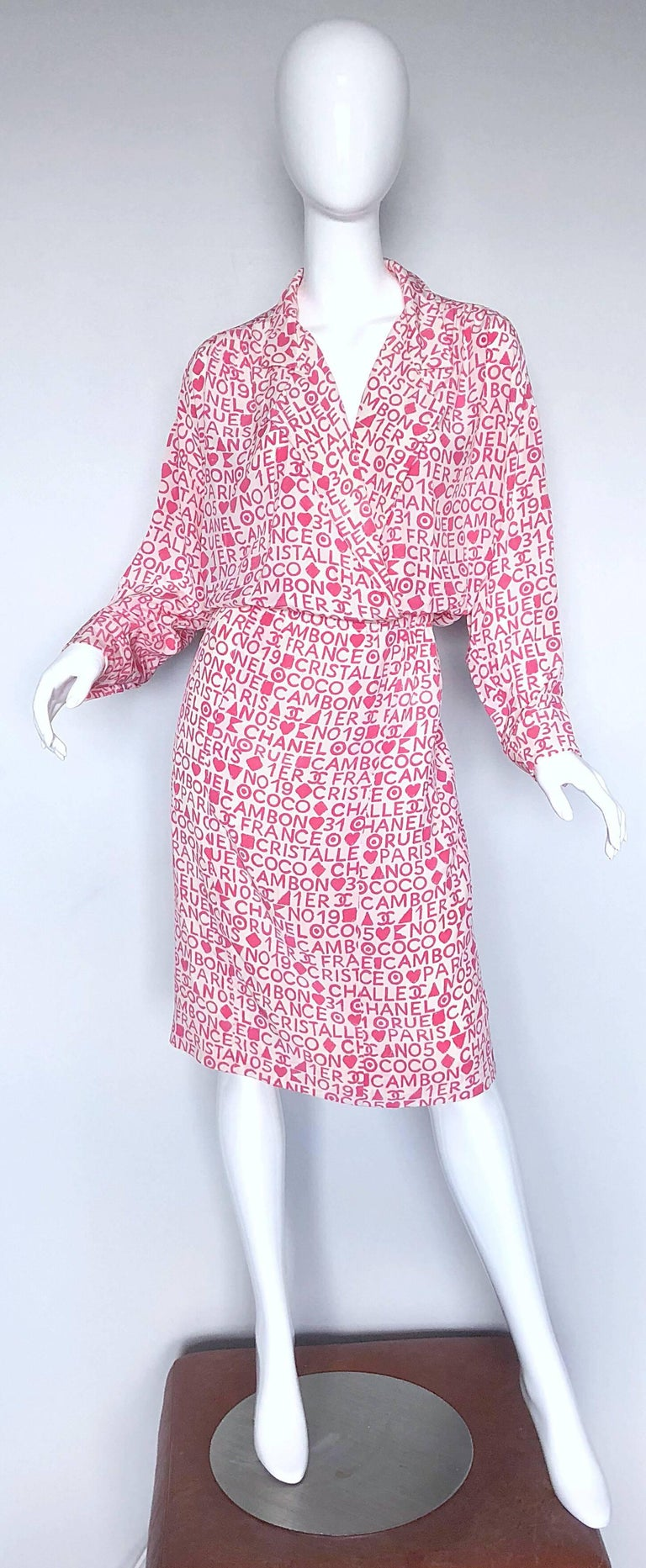 Rare vintage CHANEL early 90s larger size pink and white logo print silk shirt dress! Unbelievably chic print with a flattering fit. Interior hook-and-eye closures at waist. Elastic waistband offers plenty of stretch, and the ability to adjust to
