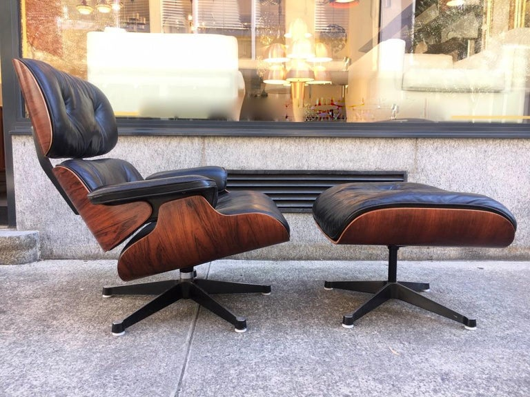 Vintage Charles & Ray Eames rosewood and black leather lounge chair and ottoman, edited by Vitra / Herman Miller, circa 1975