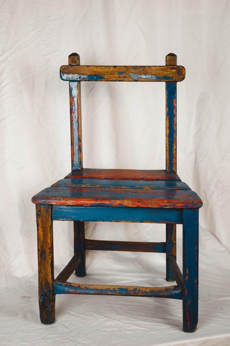 A cute vintage child's chair from France. Handmade from pine with a charming worn red and blue painted patina. This would delight any child wanting his 'own chair' and would be charming just sitting alone beside the hearth.