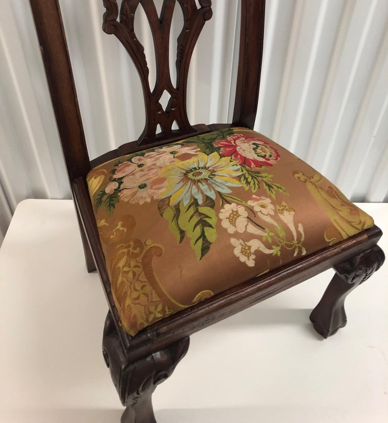 """Vintage child's chair upholstered with an 18th century French silk textile. Wood hand carved chair with a dark mahogany stained color. Chair frame is from the 1940s, Textile is an antique. 16"""" W x 25.1/4"""" BH x 12.5"""" D x 13"""" SH x 10"""" SD."""