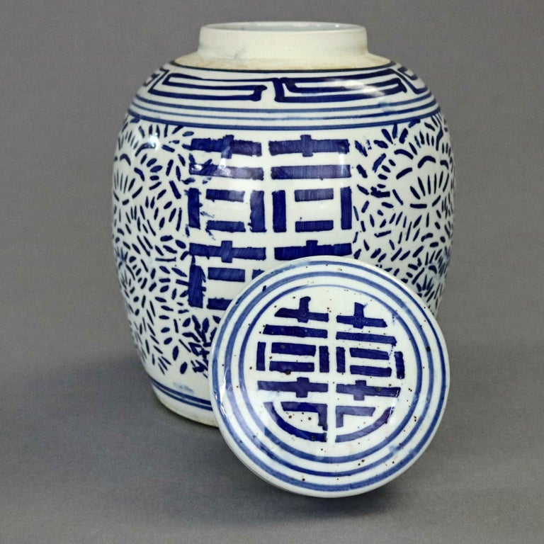 Vintage Chinese blue and white porcelain ginger jar offers hand painted all-over stylized foliate decoration with central double happy symbol, 20th century  ***DELIVERY NOTICE – Due to COVID-19 we are employing NO-CONTACT PRACTICES in the transfer