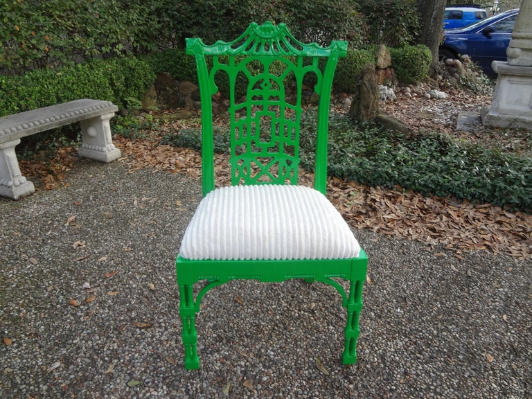 Vintage Chinese Chippendale style chair in a gorgeous green lacquered finish. This chair has beautiful detailing and has been professionally upholstered in a white cut velvet. This chair or side chair is truly Hollywood Regency glamour!