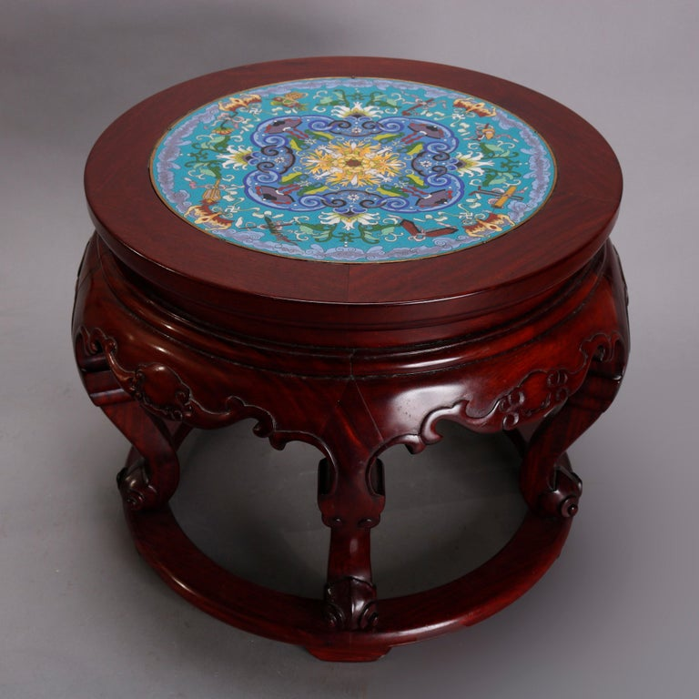 A vintage Chinese low table offers Cloisonne inset top having floral motif seated in carved mahogany base with shaped skirt raised on cabriole legs, 20th century  ***DELIVERY NOTICE – Due to COVID-19 we are employing NO-CONTACT PRACTICES in the