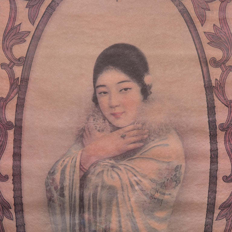 This framed advertising poster for Hatamen Cigarettes from the late 1920s melds the meticulous detail of traditional Chinese painting with the nuanced color and fine resolution of color lithography. Ensconced in a filigree frame, a woman peers out