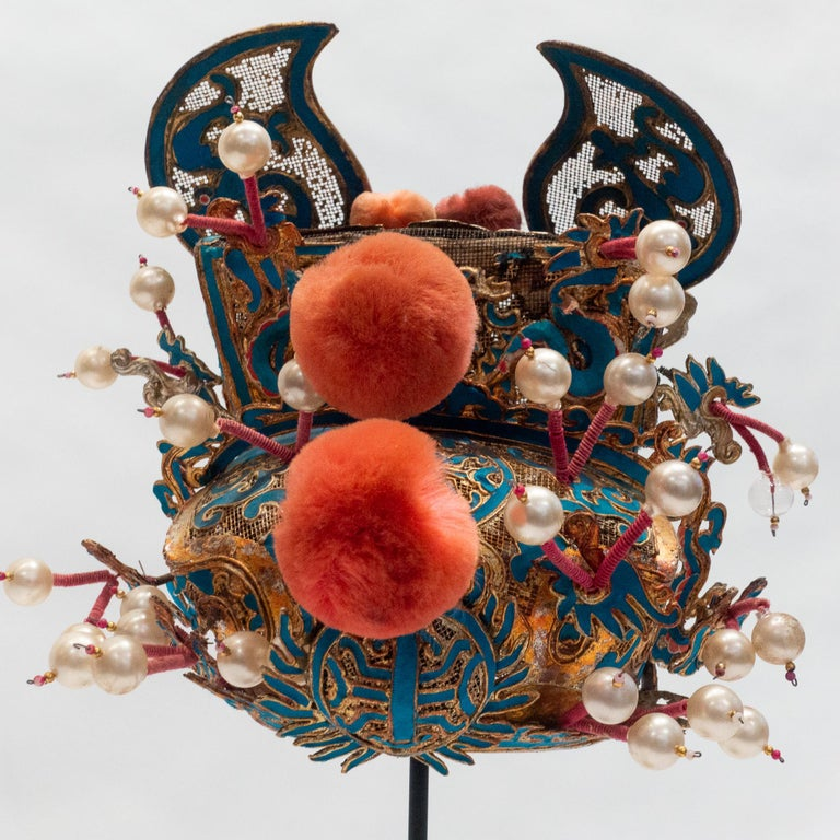 Vintage Chinese opera theatre headdress, early 20th century, mounted on a custom, black painted metal base.   Price not adjusted.