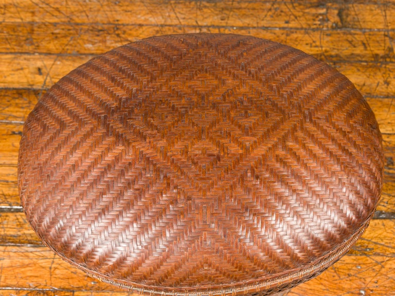 Vintage Chinese Oval Woven Rattan Basket with Lid and Geometric Motifs In Good Condition For Sale In Yonkers, NY