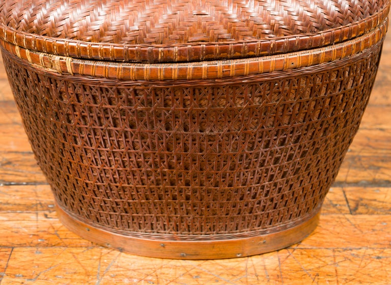 20th Century Vintage Chinese Oval Woven Rattan Basket with Lid and Geometric Motifs For Sale