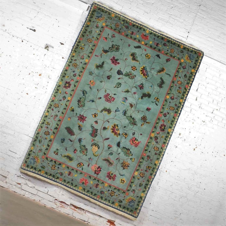 Handsome vintage wool 6' x 8.9' handmade Chinese Peking rug in a gorgeous soft teal green with border design and overall center pattern it is in fabulous vintage condition. We have cleaned the rug thoroughly but there may still be small stains but