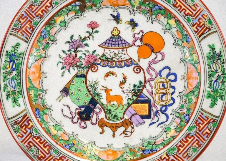 This porcelain plate is an original decorative object realized in China by Chinese manufacture, at the beginning of the 20th century.   It is decorated with geometric and floral ornaments along the edges.  Authentic Chinese marks under the base.