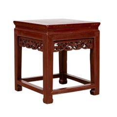 Vintage Chinese Side Table with Dark Red Patina and Foliage Hand Carved Apron