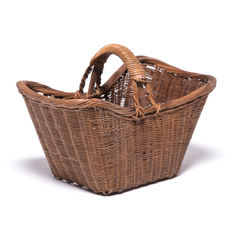 It's easy to imagine someone, long ago, walking to market on a beautiful summer day with this beautiful basket slung over their arm. Basket making is an ancient and humble Craft, but in the hands of a truly skilled weaver willow branches, like