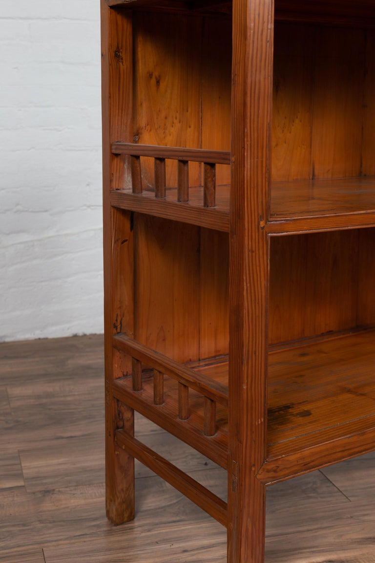 Vintage Chinese Two-Part Elmwood Bookcase with Pillar-Shaped Strut Motifs For Sale 7