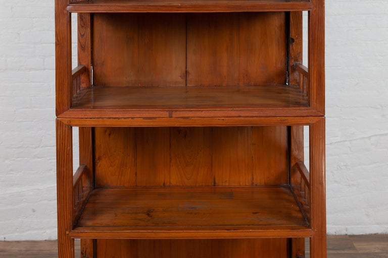 20th Century Vintage Chinese Two-Part Elmwood Bookcase with Pillar-Shaped Strut Motifs For Sale