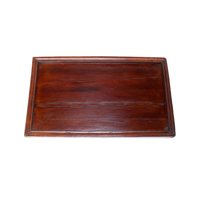 Simple lines, a modest form, and a layer of hand-brushed lacquer give this shallow Qing-dynasty tray a Provincial charm. A tray like this would have been used to by a street vendor to display their wares to passersby. We love the simple tray as an