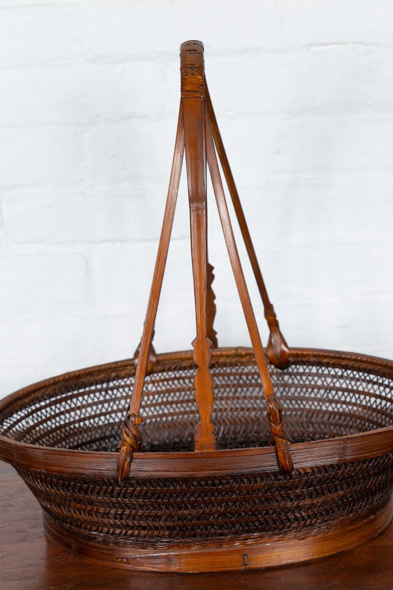 Vintage Chinese Woven Rattan Carrying Basket with Large Tripartite Handle In Good Condition For Sale In Yonkers, NY