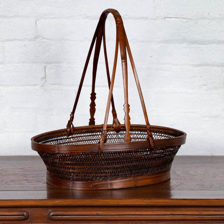 Vintage Chinese Woven Rattan Carrying Basket with Large Tripartite Handle For Sale 1