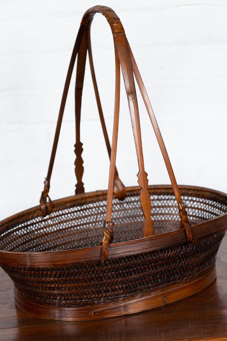 Vintage Chinese Woven Rattan Carrying Basket with Large Tripartite Handle For Sale 2