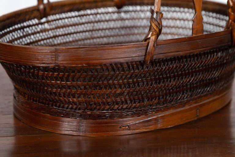 Vintage Chinese Woven Rattan Carrying Basket with Large Tripartite Handle For Sale 3