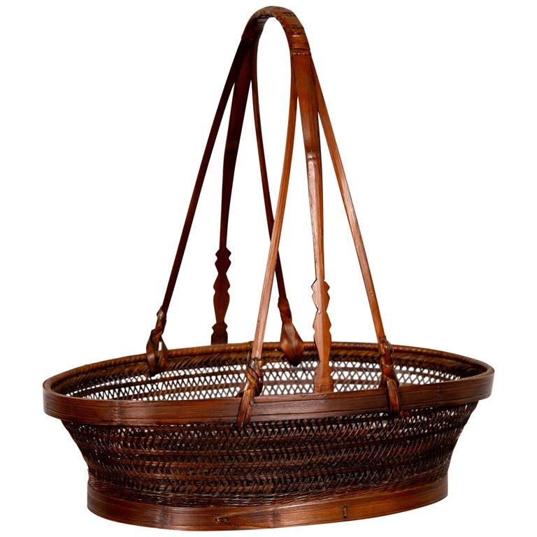 Vintage Chinese Woven Rattan Carrying Basket with Large Tripartite Handle For Sale